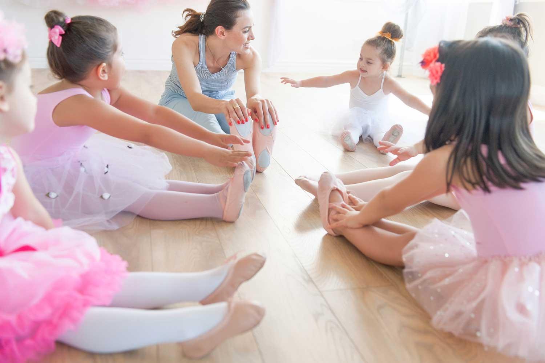 Stella stretching with her students   Stellar Dance Studio