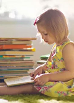 A girl reads a book