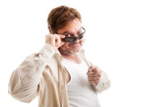 Middle-aged man with sunglasses, who thinks he's cool, trying to
