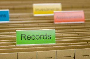 A hanging file folder labeled with Records