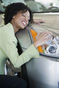 Woman hugging her car