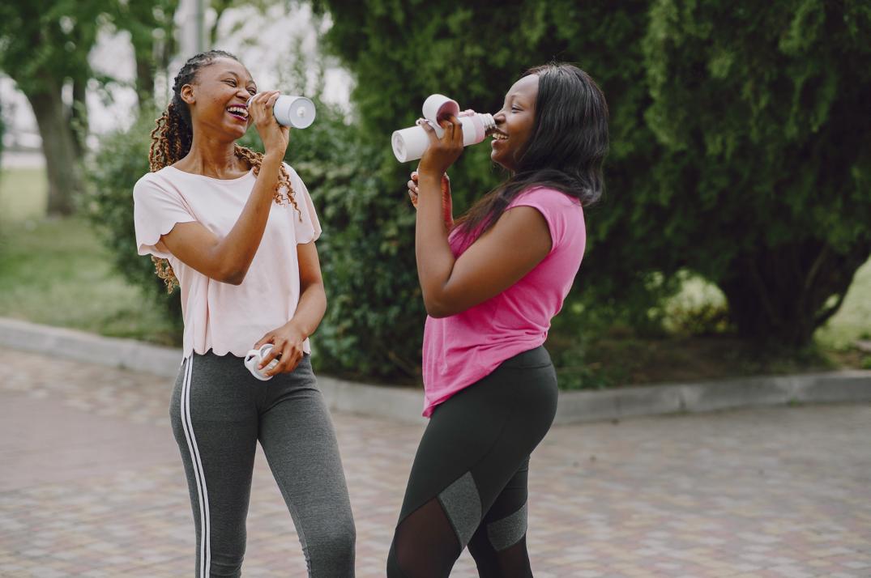 2 women drinking water
