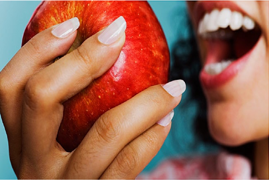 Close up women eating apple