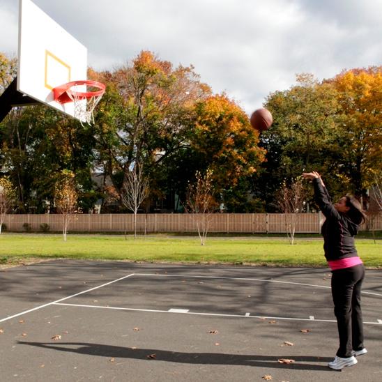 child shooting basketball