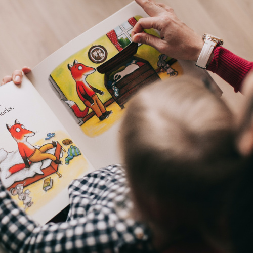 child reading picture book about a fox
