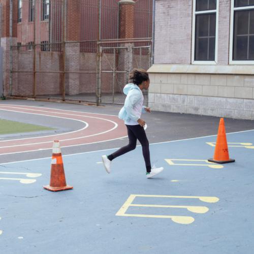child running between pylons