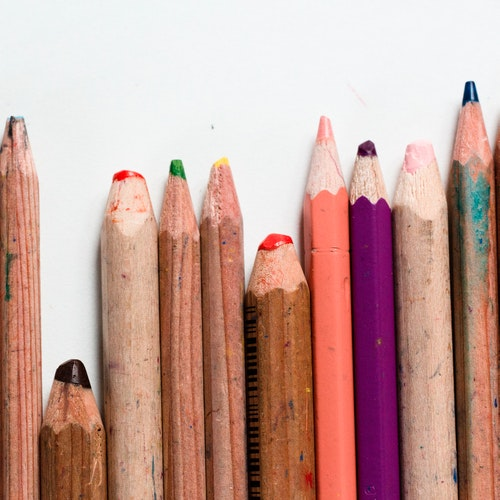 Coloured pencils of different lengths and sharpness.