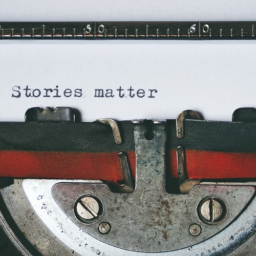"""""""Stories matter"""" typed with a typewriter."""