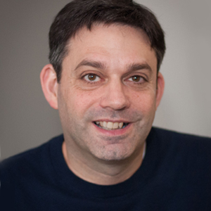 Man smiling for headshot