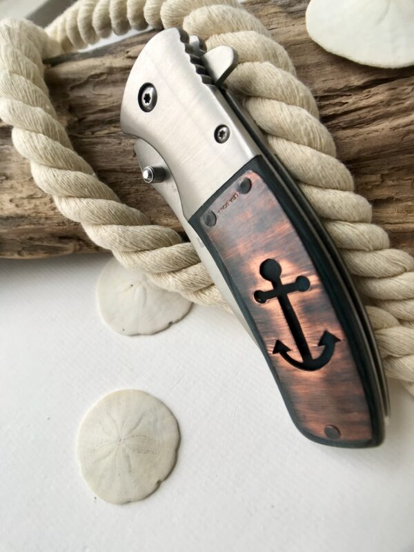 Customized pocket knife with hand-cut anchor design - Copper