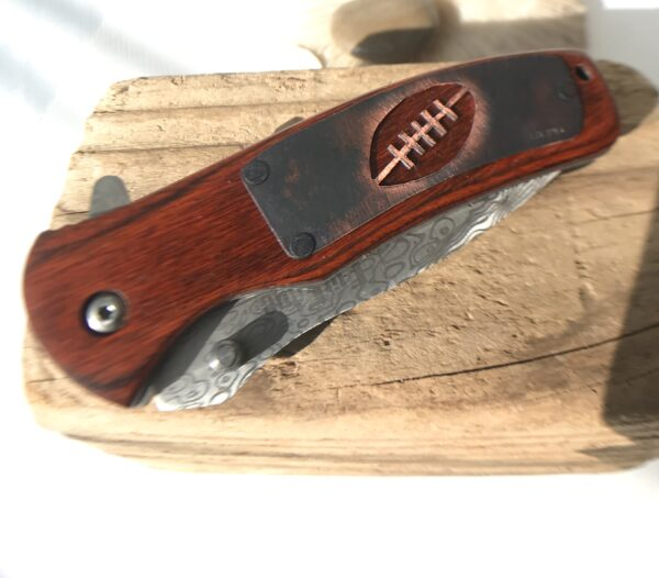 Customized pocket knife with hand-cut 'Football' design - Copper
