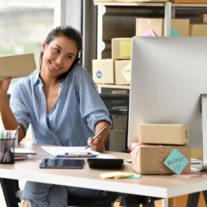 young-asian-woman-entrepreneur-business-owner-working-with-computer-home