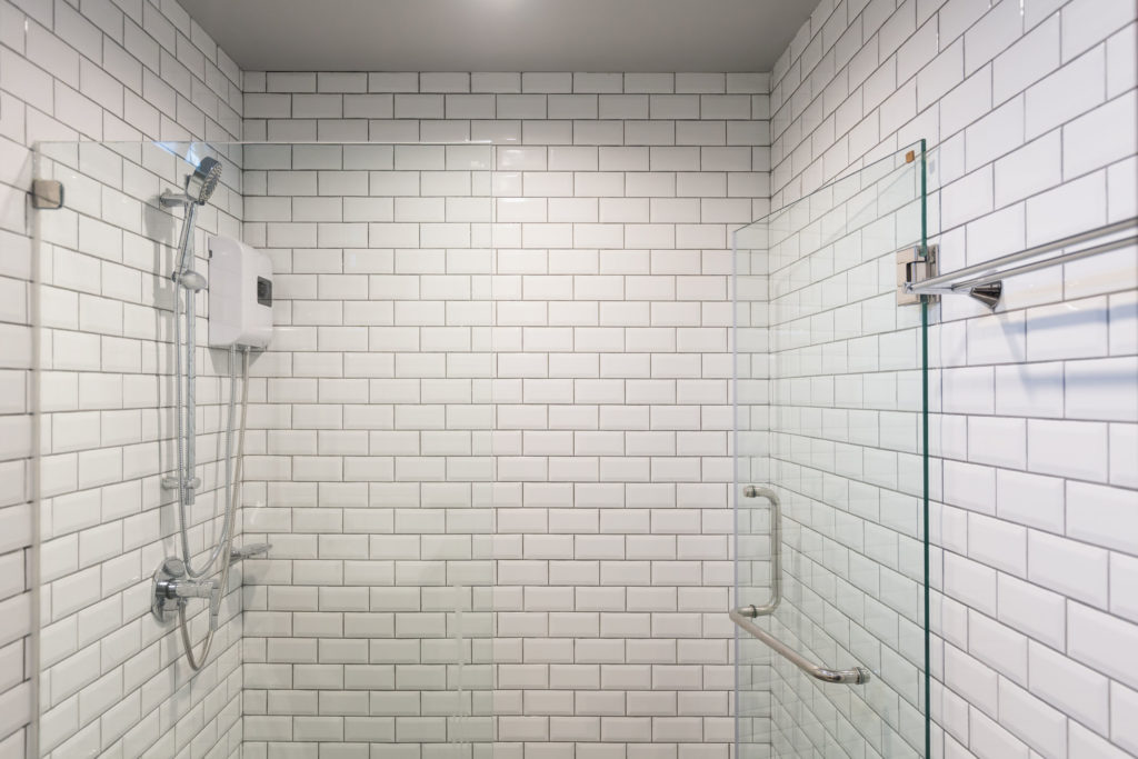 74256985 - big glass shower box in a clean white white room.