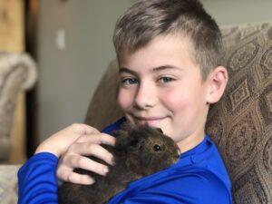 Boy holding Pet Hamster