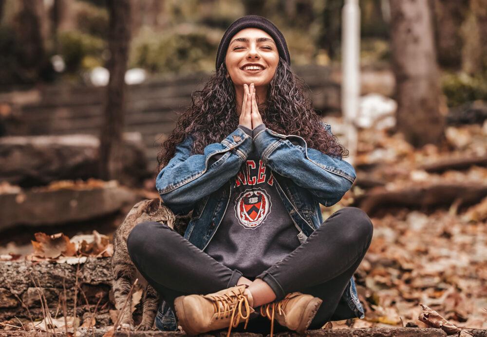 girl smiling in meditation position