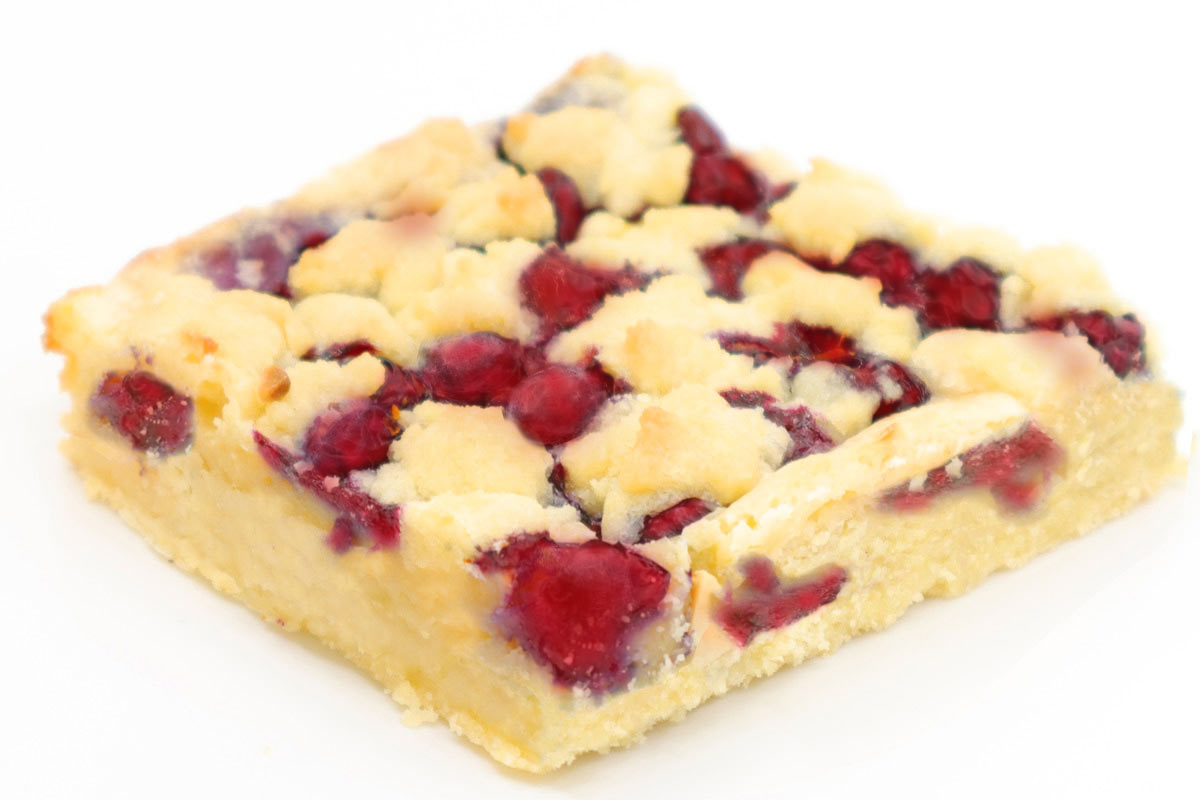 A light shortbread layered with fresh blackberries, goat cheese, rosemary, & sliced almonds.