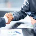 Shaking Hands After Securing a Bridge Loan for a Real Estate Investment