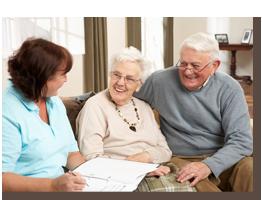 elderly couple receiving information from coordinator