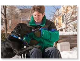 adult in wheelchair with service dog