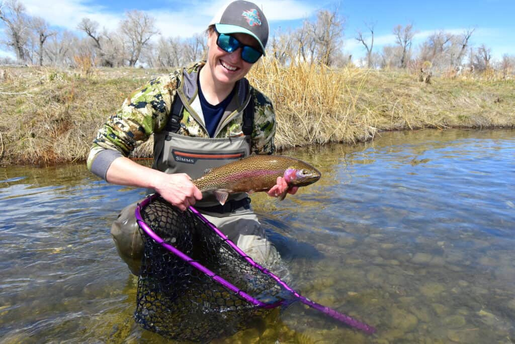 A fly fishing beginner's first catch
