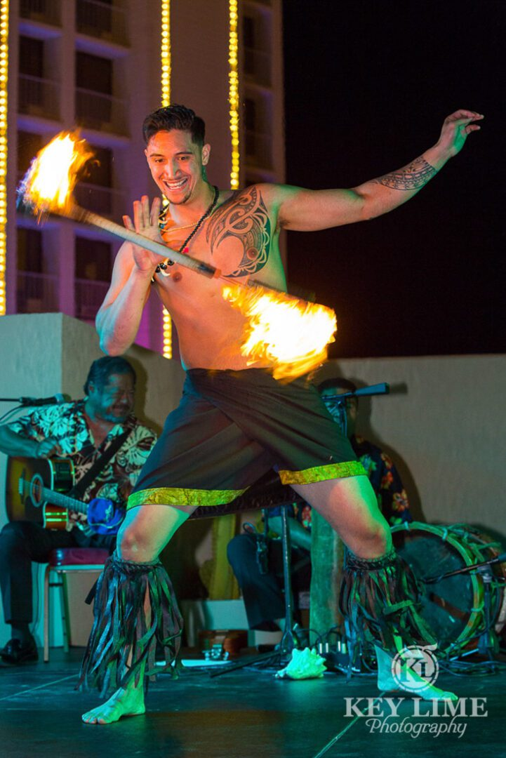 Rooftop party photos of luau at plaza hotel. fire juggler