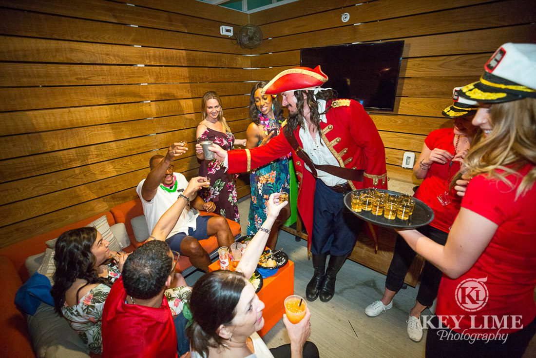 Private cabana at the rooftop party at Plaza Hotel and Casino. Photo by Key Lime Photography. Captain Morgan proposing a toast