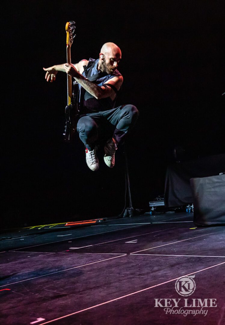 X Ambassadors front man catching air during a show in Las Vegas. OBC photo by Key Lime Photography