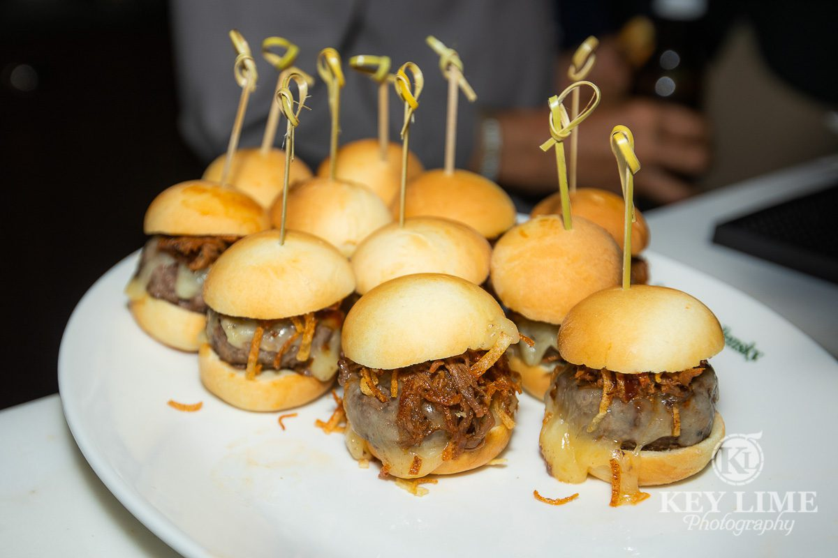 Appetizer sliders on a white serving plate