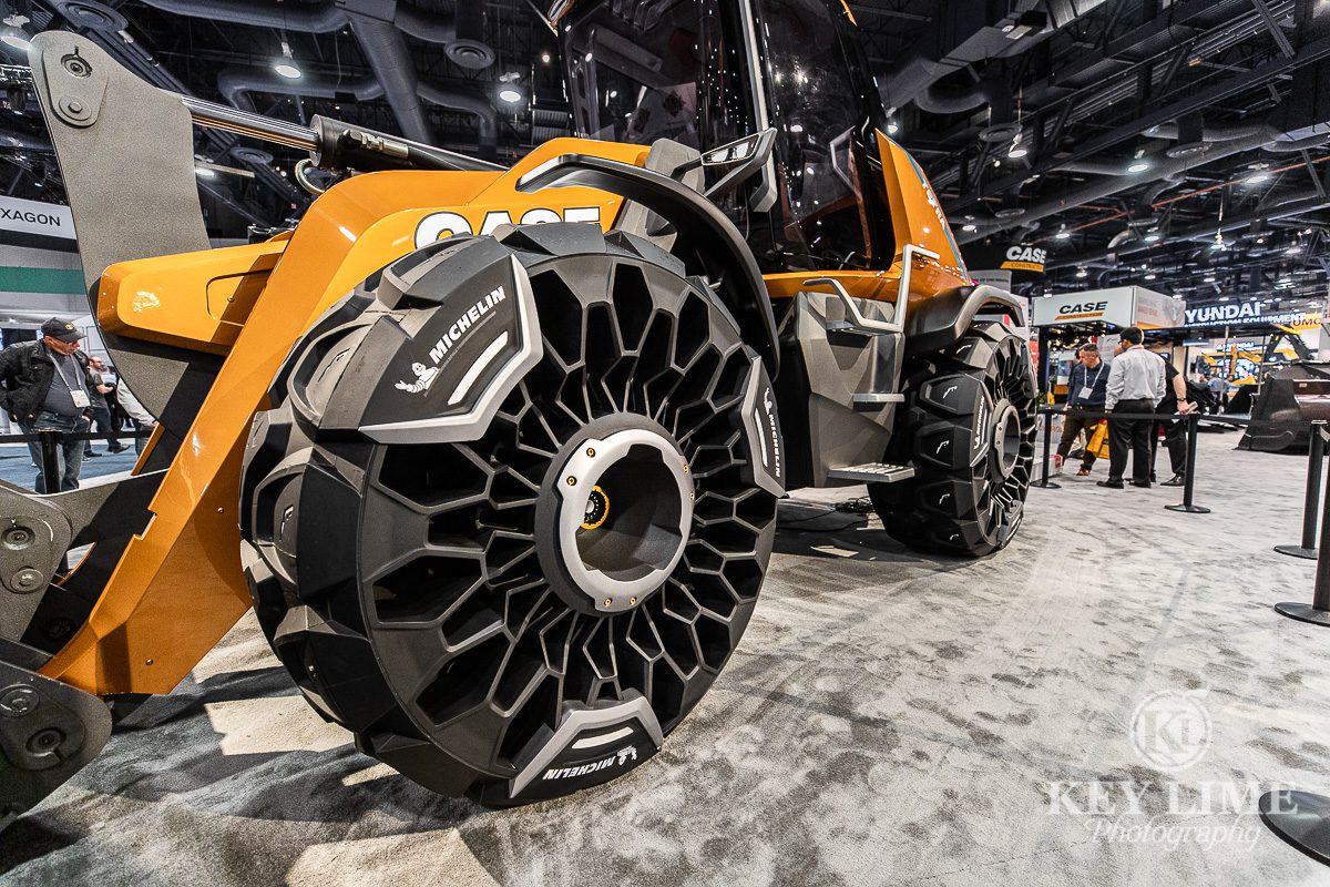 Construction photography of Case Construction's unveiled concept Tetra, the first bio-methane equipment. ConExpo 2020 photo of heavy equipment that looks like a sports car.