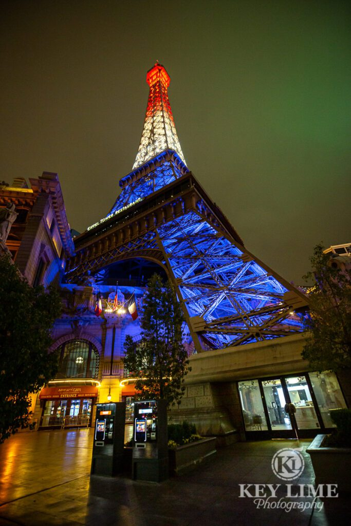 Red, white and blue lights on the quiet Eiffel tower, Vegas strip