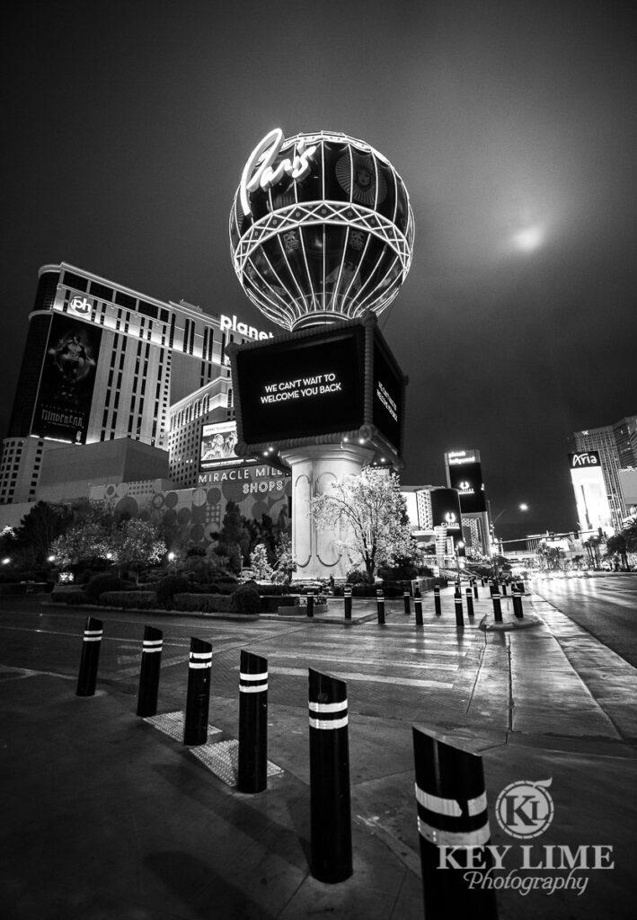 black and white photo of empty streets and sidewalk near Paris hotel hot air balloon. Coronavirus quarantine