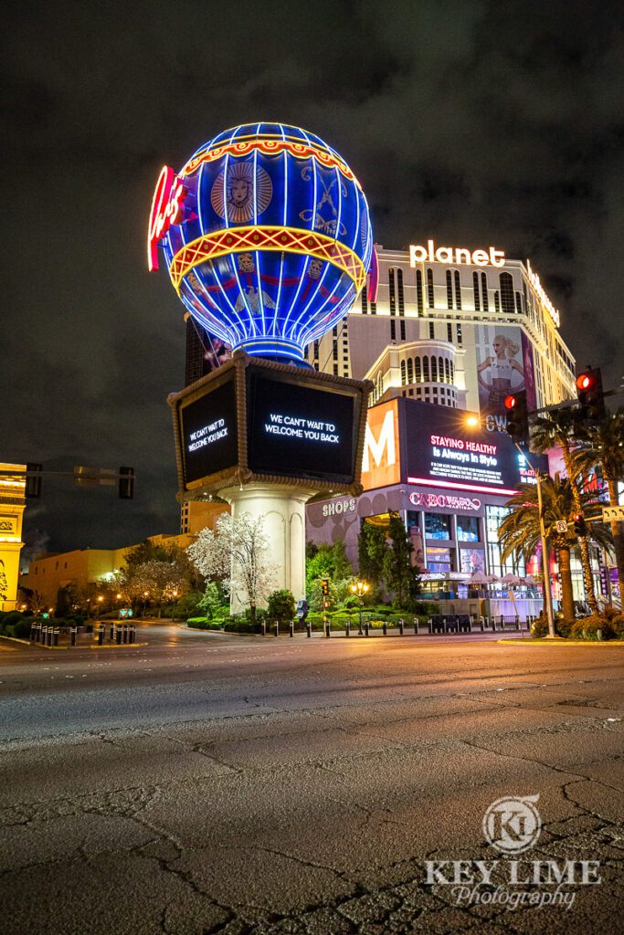 Paris Hotel, qiet boulevard with Paris Balloon and Planet Hollywood Hotel in Vegas