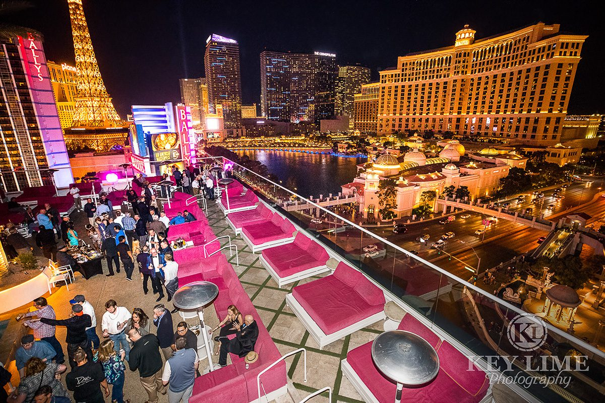 Unbeatable strip views over the Bellagio Fountains. Event photographer image of evening rooftop party
