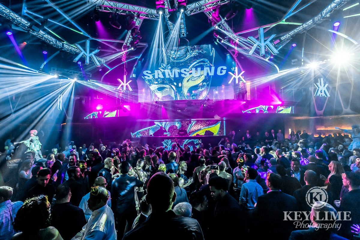 Nightclub corporate party with Samsung banner and extravagant lighting. Event photographer photo.