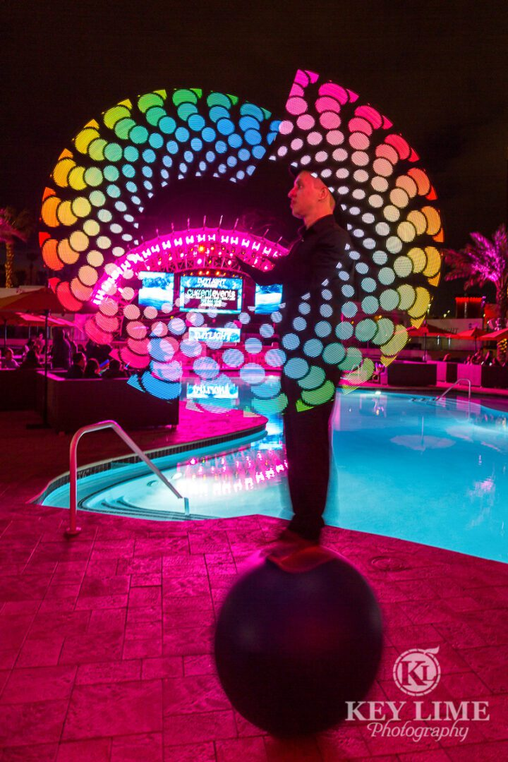 Unique event performer in Las Vegas. LED sign spinner on a balancing ball.