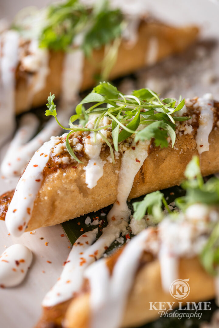 Mexican gourmet taquitos. Food photography features attractive colors and visible textures.