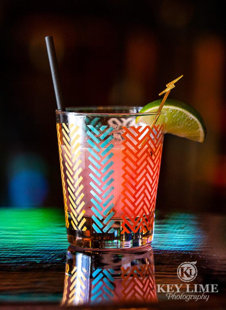 Fun, colorful cocktail with lightening bolt stir stick.