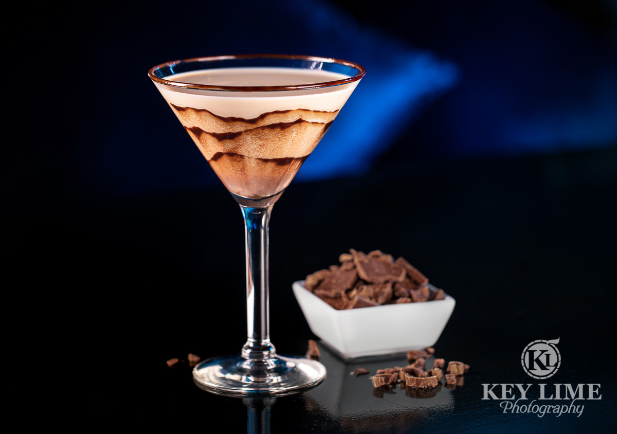 Drink photographer image of a chocolate cocktail in a martini glass