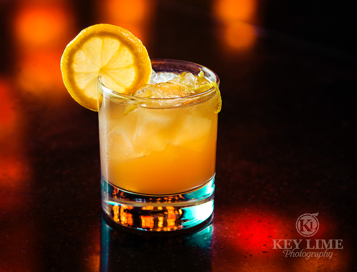 Citrus cocktail will elegant reflections and color accents.