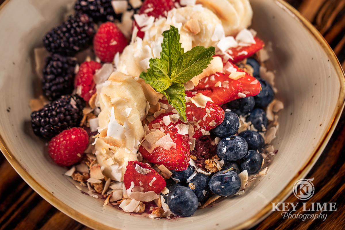 Food photographer in Las Vegas. Image of healthy breakfast. Raspberries, blueberries, strawberries, bananas and oatmeal