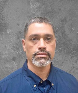 gray headed man in dark blue shirt