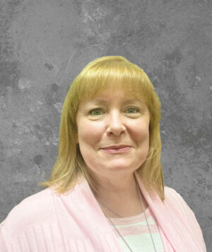 blonde lady in a pink jacket