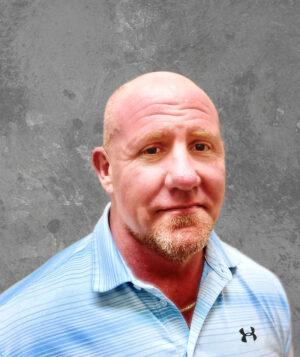 bald man in a blue shirt