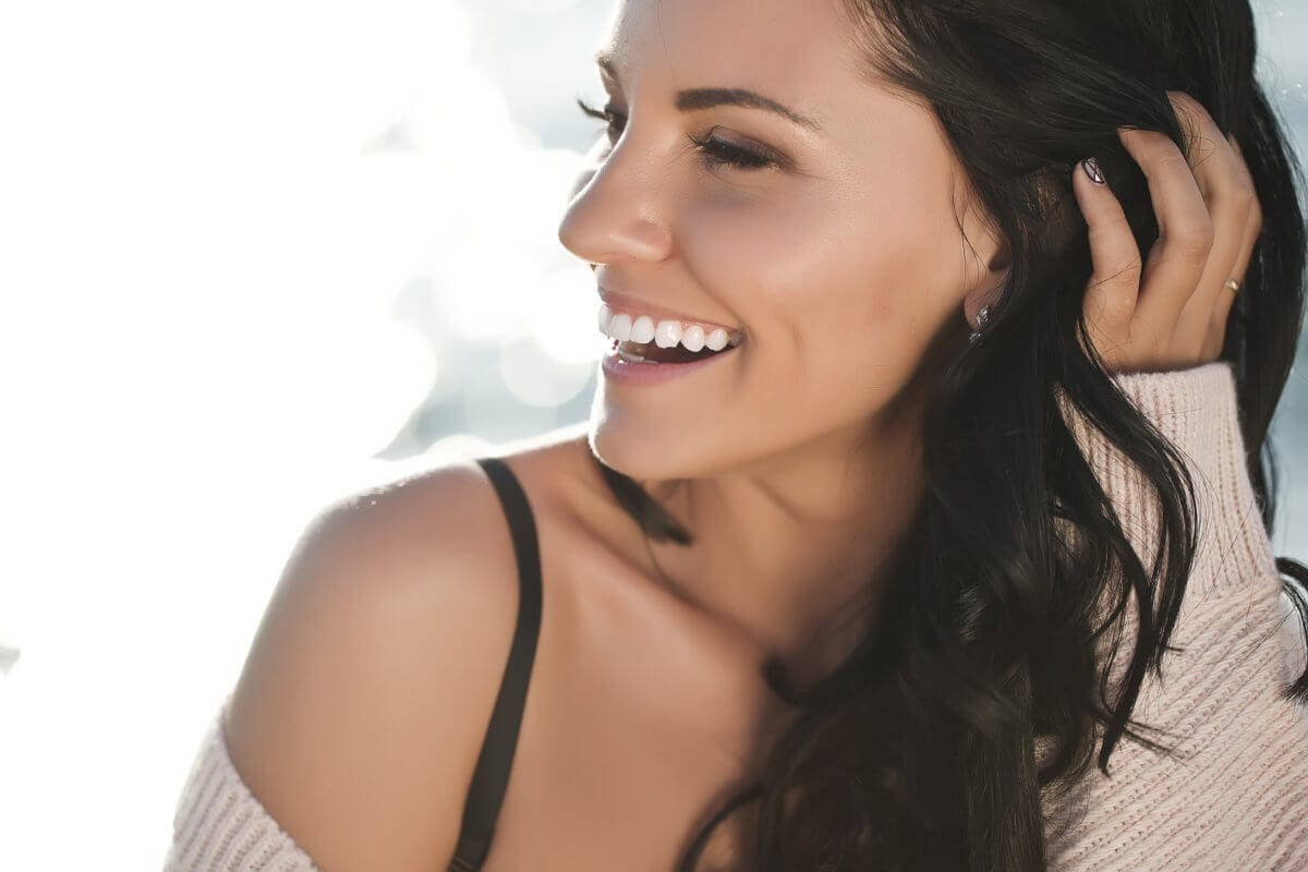 Woman smiling looking off into the distance