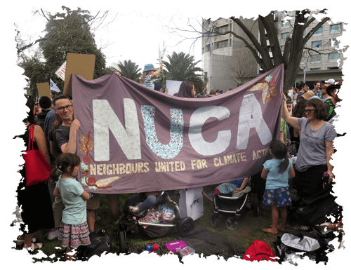 People holding NUCA flag at a climate rally