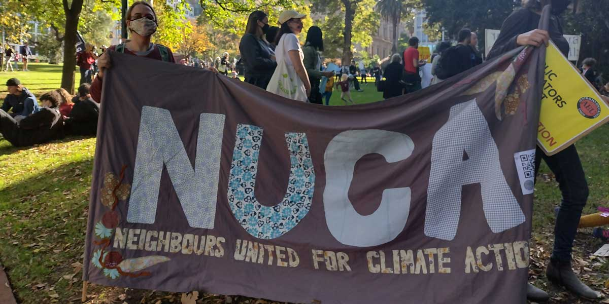 Maggie holding the NUCA banner