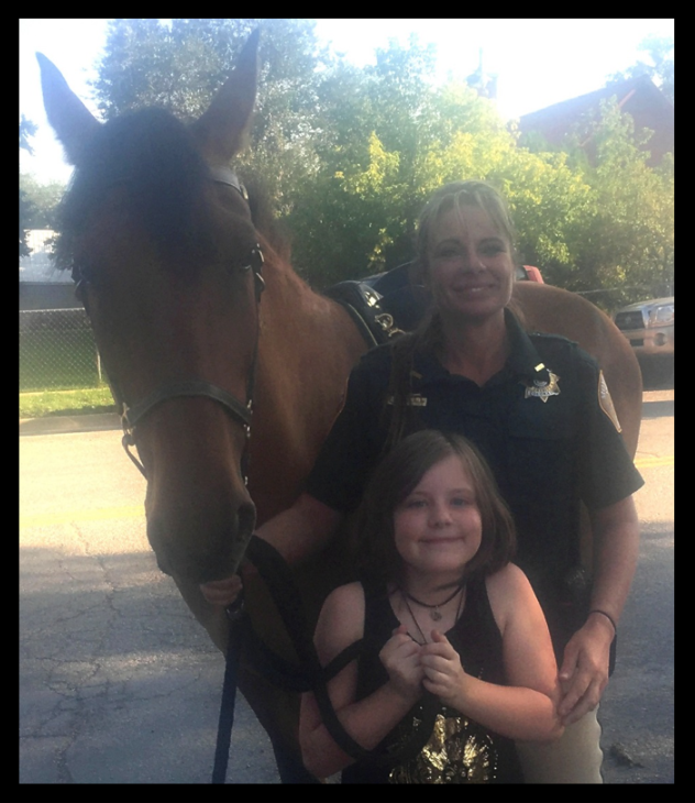 Kaitlynn Bane from Mancos Elementary School picked out Cody's name. Kaitlynn is pictured with Detective Yvonne McClellen and Cody.