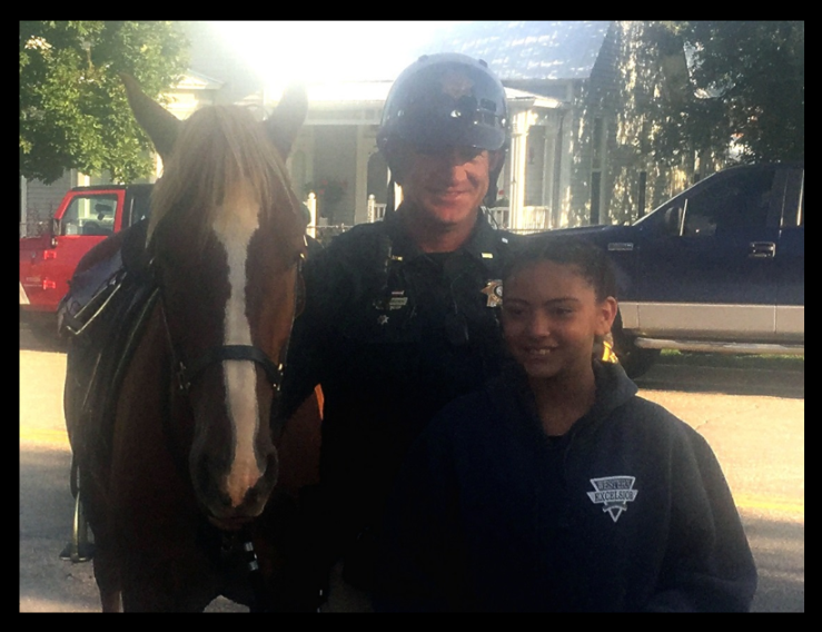 Kiki Ford from Mancos Elementary School picked out Rebel's name. Kiki is pictured with Deputy Donnie Brown and Rebel.