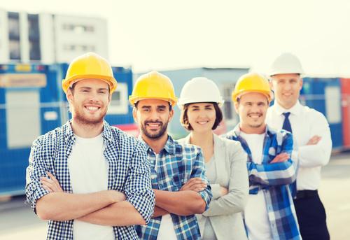 happy construction team shutterstock_325469345