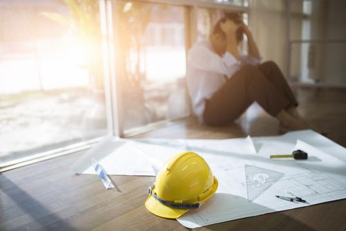 stressed construction workder by CrispyPork shutterstock_745589800